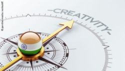 Image: Compass pointing towards the word creativity. In the compass's center is a ball that shows the Indian flag; Copyright: panthermedia.net/eabff
