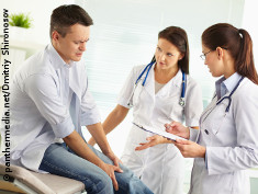 Photo: Patient and two doctors