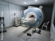 Photo: Person lying in a MRI