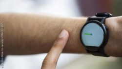Photo: finger on smartwatch