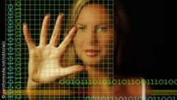 Photo: Binary code overlays a picture of a woman