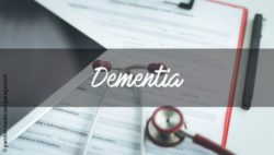"Image: documents and a stetoscope are lying on the table, the word ""Dementia"" stands in front of it; Copyright: panthermedia.net/garagestock"