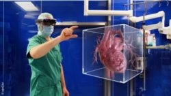 Image: A physician wearing VR glasses. An image of the human heart floats in front of him in the air; Copyright: apoQlar