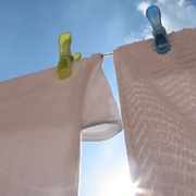 Photo: White washed laundry drying in the sun