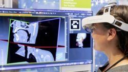 Image: Trade fair visitor is looking at imaging data using AR glasses; Copyright: Messe Düsseldorf