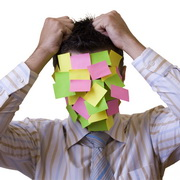Photo: A desperate man with many post-it notes at his head