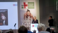 Image: Speaker and audience at the MEDICA MEDICINE + SPORTS CONFERENCE; Copyright: Messe Düsseldorf