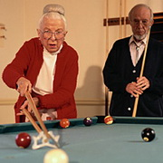 Photo: Old woman and old man plaing pool together