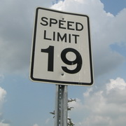 "Photo: Street sign saying ""Speed Limit 19"""