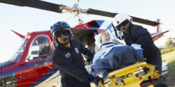 Photo: Patient is brought from the rescue chopper to the hospital; Copyright: panthermedia.net/Monkeybusiness Images
