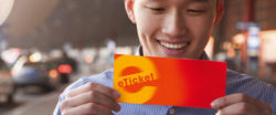 Image: Smiling man with voucher / eTicket