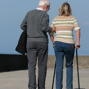 Photo: Man and woman with crutches