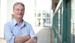 Image: Mark Pallen, standing outside beside a building; Copyright: University of Warwick