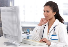 Photo: Physician on computer