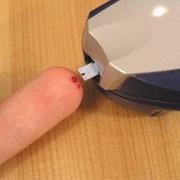 Photo: A drop of blood  is taken from the finger