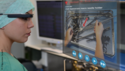 Image: Female hospital employee with green OR cap is wearing AR glasses, a screen is floating in front of her; Copyright: IT4process GmbH