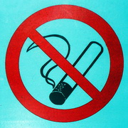 Photo: Sign with a burning cigarette crossed
