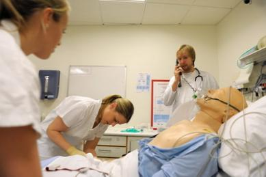 Photo: Physicians training with a simulation dummy