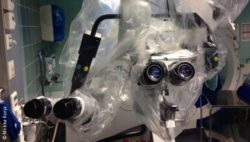 Photo: A microscope in the OR, covered with plastic foil
