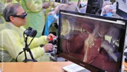 Photo: Asian physician is using a surgical robot