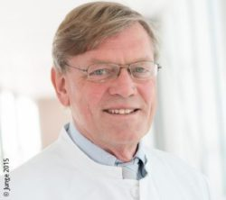 Image: smiling man with glasses and doctor's gown over shirt and tie - Prof. Axel Haverich; Copyright: Junge 2015