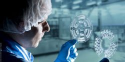 Photo: Researcher is looking at microfluidic LabDisc; Copyright: Hahn-Schickard/Bernd Müller Fotografie