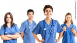 Image: Nurse in the foreground, behind whom four other nurses are placed; Copyright: panthermedia.net/minervastock