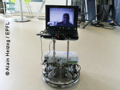 Photo: Roboter with picture of a patient on it