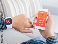 Photo: Man measures his heart rate via watch and app