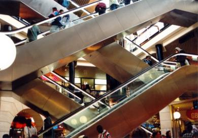 Photo: Moving stairways in all directions in a shopping mall