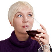Photo: Young woman drinks wine