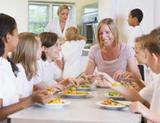 Photo: Children and teacher eating