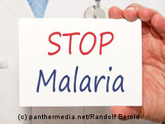 "Photo: Doctor with sign ""Stop Malaria"""