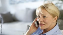 Photo: Older woman speaks at the phone