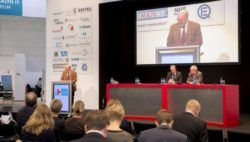 Image: Speaker at the stage of MEDICA HEALTH IT FORUM
