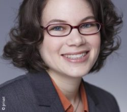 Photo: Young woman with short black hair and glasses - Dr. Kathrin Doppler; Copyright: private