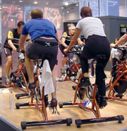 Photo: Men cycling in gym