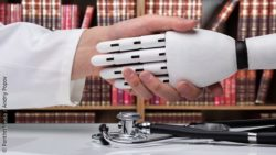 Image: Doctors shakes Roboters hand; Copyright: PantherMedia / Andriy Popov