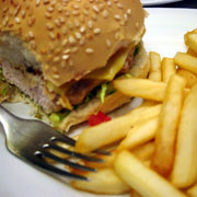 Photo: A hamburger and chips on a plate