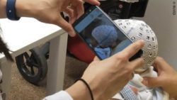 Image: someone taking measurements with Photomedas of a skull via smartphone; Copyright: RUVID