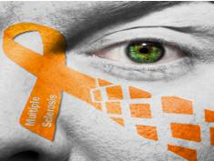 Photo: Multiple Sclerosis Ribbon laid over a face