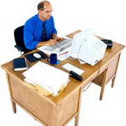 Photo: Man working in an office