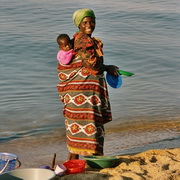 Photo: Woman with child on her back