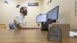 "Image: Ben Klos, a nurse of the team who investigated the best ""dose"" of telehealth, is sitting on a computer; Copyright: Brian Persinger/WVU"