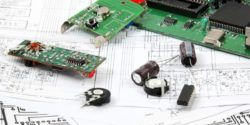 Image: Electronic components on top of a circuit diagram; Copyright: panthermedia.net/mpanch