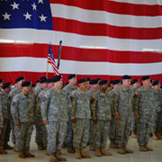Photo: Soldiers mustering in front of an American flag