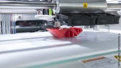 Image: 3D printer printing something red; Copyright: PantherMedia / RomboStudio