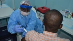 Image: A volunteer receives an injection in the PREVAIL Ebola vaccine clinical trial; Copyright: PREVAIL